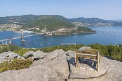 View of Vigo estuary Pontevedra, Spain. Wooden bench in Redondela Pontevedra, Spain Royalty Free Stock Photo
