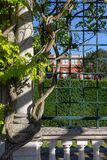 View of villa garden over old metal grid stock photo