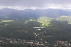 View of the village Aderbievka and Greater Caucasus Range rainy summer day Royalty Free Stock Photos