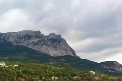 View from the village of Alupka on mount AI-Petri on a cloudy da. Y. Crimean tourist attraction royalty free stock images