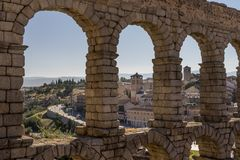 Aqueduct in Segovia, Spain. View of the village through the ancient roman aqueduct in Segovia Spain stock image