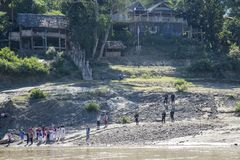 Cruising the Salween River. View of a village as people gather along the Salween River between Myanmar and Thailand. Seen while cruising stock photography