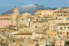 View of village and belltower on background Etna Royalty Free Stock Photography