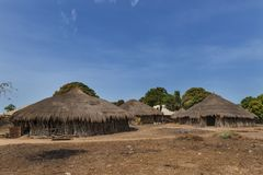 View of the village of Eticoga in the island of Orango with traditional huts. royalty free stock images