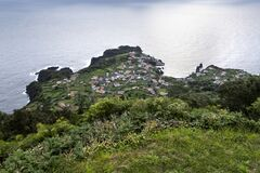 View on the village of Fajã do Ouvidor, a permanent debris field, built from the collapsing cliffs on the northern coast of the
