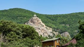 View from the village of foros on the Church of the resurrection against a green forest. View from the village of foros on the Church of the resurrection against royalty free stock photography