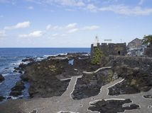 View on village Garachico with sea pools and lava rocks and main royalty free stock photos