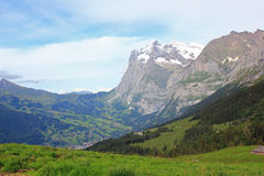 View at the village Grindelwald in Berner Oberland in Switzerland. View from above at the village Grindelwald, with the Wetterhorn and the Schreckhorn. Berner Stock Image