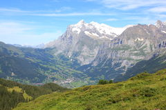 View at the village Grindelwald with mountains in Switzerland. View at the village Grindelwald with the mountains of Berner Oberland, Switzerland. The Stock Image