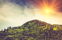 A view of the village houses on a mountain hill. A view of the village houses on a mountain hill at sunshine Royalty Free Stock Photography