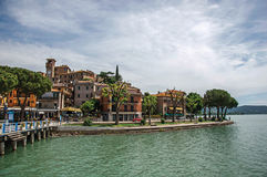 View of the village and its harbor on the shores of Lake Trasimeno. Passignano sul Trasimeno, Italy - May 15, 2013. View of the village and its harbor on the Royalty Free Stock Photos