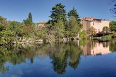 `Le Thor` and the river of the Sorgue - Vaucluse - France. View of the village `Le Thor` and the river of the Sorgue - Vaucluse - France Stock Image