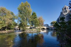 `Le Thor` and the river of the Sorgue - Vaucluse - France. View of the village `Le Thor` and the river of the Sorgue - Vaucluse - France Stock Photo