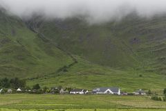 View of a village located on the Plockton hills. Countryside landscape of a rural village on the Plockton hills in a cloudy morning Stock Photography