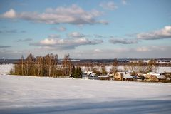 View of the village in the middle of the field in winter. The village of Kutepovo in Russia. Zhukovskiy district, Kaluzhskiy region royalty free stock images