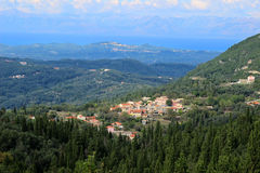 View of the village in a mountain valley. Mountain view and sea view. Ionian sea and Paleokastritsa Stock Image