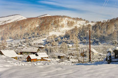 View of the village in the mountains on a sunny day in winter Royalty Free Stock Photo