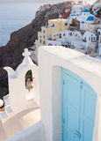 View of the village Oia with blue door. Stock Photo