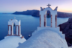 View of the village Oia on the sunset. Royalty Free Stock Images