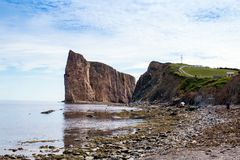 View of the village of Perce cliff from the pierced rock at low. Tide Stock Images