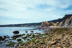 View of the village of Perce cliff from the pierced rock. At low tide Royalty Free Stock Photography