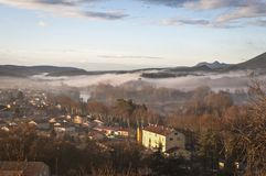 View of the village Saint Bauzille de Putois, Herault, France. View of the village Saint Bauzille de Putois in fog, Herault, France royalty free stock photo