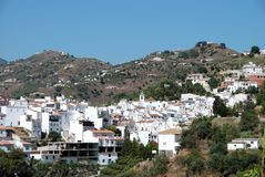 View of village, Sayalonga, Andalusia, Spain. View of the town and church with mountains to the rear, Sayalonga, Axarquia region, Malaga Province, Andalusia Royalty Free Stock Photos