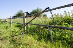 Village tool scythe fence background stock photos
