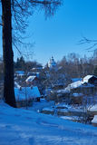 View of village from top of hill in winter. A view of the village from the top of the hill in winter Stock Image