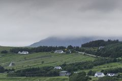 View of a village on the Ullapool hills. Countryside landscape of a rural village on the Ullapool hills in a cloudy morning Stock Photos