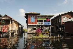Stilt houses on Inle Lake. View of a village of wooden houses and stilt houses on the inle lake. Myanmar stock photography
