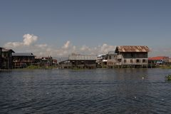 Stilt houses on Inle Lake. View of a village of wooden houses and stilt houses on the inle lake. Myanmar royalty free stock image
