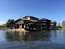 Stilt houses on Inle Lake. View of a village of wooden houses and stilt houses on the inle lake. Myanmar royalty free stock images