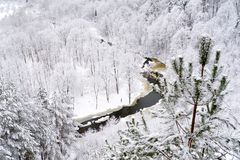View of Vilnia river from geological Puckoriai exposure in Vilnius, the highest exposure in Lithuania. Chilly winter day royalty free stock image