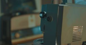 Vintage film projector. View of a vintage projector working in dark room with super 8 mm film stock video