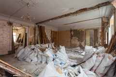 View of the vintage room with fretwork on the ceiling of the apartment and retro chandelier during under renovation, remodeling. And construction.nThe process Stock Photo