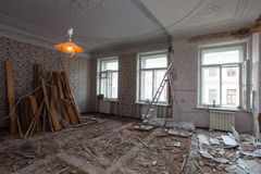 View the vintage room with fretwork on the ceiling of the apartment during under renovation, remodeling and construction.  Stock Photography