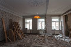 View the vintage room with fretwork on the ceiling of the apartment during under renovation, remodeling and construction.  Stock Photos