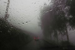View of violent storm with heavy rainfall through the windshield of car. View of violent storm with heavy rainfall seen through the windshield of car while royalty free stock images