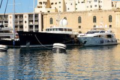 The view on Vittoriosa and modern yachts in sunset. Malta Stock Images