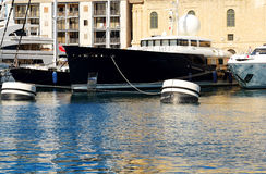 The view on Vittoriosa and modern yachts in sunset. Malta Royalty Free Stock Photography