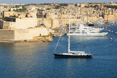 The view on Vittoriosa and yachts in sunset. Malta Royalty Free Stock Photography