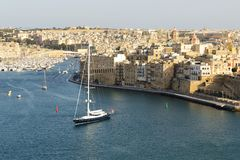 The view on Vittoriosa and yachts in sunset. Malta Stock Photos
