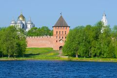 View of the Vladimir tower and domes of St. Sophia Cathedral in the May sunny day. Kremlin of Veliky Novgorod, Russia. View of the Vladimir tower and domes of St stock image