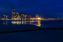 View of Vlissingen, Zeeland, Netherlands at night. View across the deserted sandy beach of Vlissingen, Zeeland, Netherlands at night with the lights from the Royalty Free Stock Images
