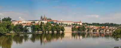 View of the Vltava Embankment, Charles Bridge and St. Vitus Cathedral in Prague, Czech Republic royalty free stock images