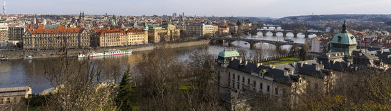 View of the Vltava River and the bridges shined with the sunset sun, Prague, the Czech Republic. Royalty Free Stock Photos