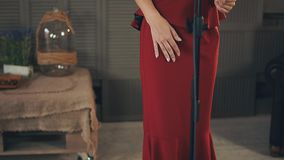 View of vocalist in red dress with bright make up perform at microphone. Dance. Jazz. Elegance stock video