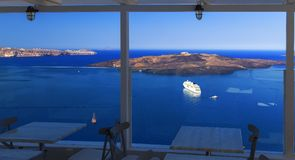View of volcanic caldera from the terrace of outdoor restaurant in Thira city, capital of Santorini island, Greece stock photo