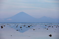 The view of the volcano Agung from Gili Trawangan in the early morning at low tide Stock Photography
